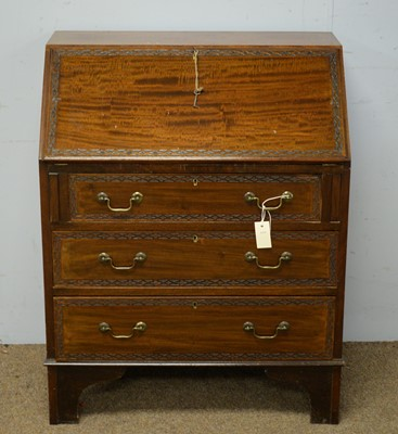 Lot 50 - An early 20th C mahogany bureau.