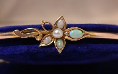 Lot 222 - An Edwardian opal, diamond, and pearl bangle.
