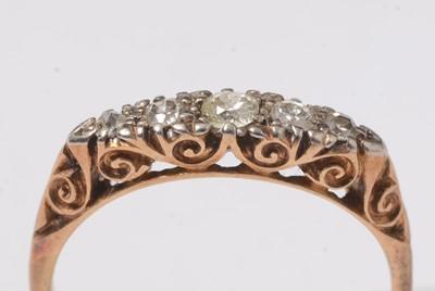 Lot 236 - A five stone diamond ring.