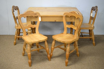 Lot 82 - Victorian-style pine dining table; and four balloon back kitchen chairs.