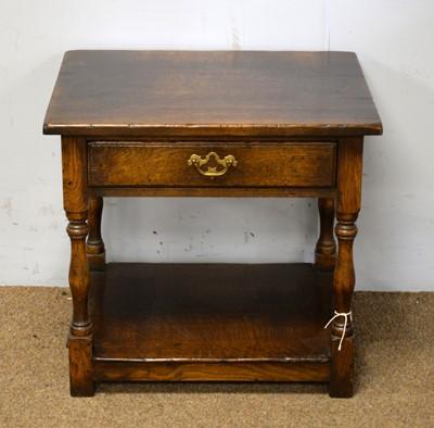 Lot 80 - A Georgian-style oak bedside table.