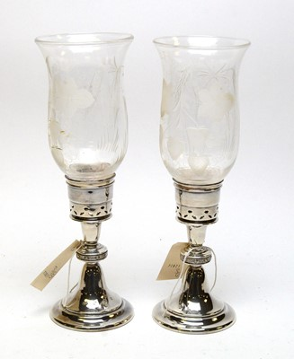 Lot 195A - A pair of silver and etched glass hurricane candlesticks.