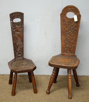 Lot 57 - Two carved oak spinning chairs of typical design.