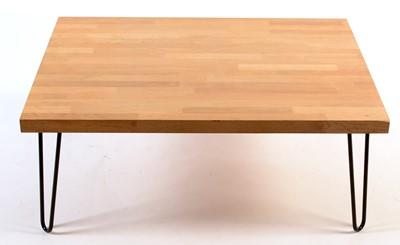 Lot 73 - Bieffe: a modern light oak coffee table.