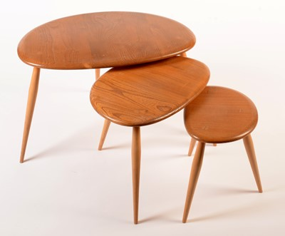 Lot 55 - Ercol: a light elm and beech nest of three tables.