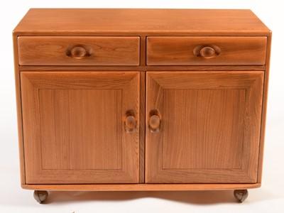 Lot 81 - Ercol: a light elm side cabinet