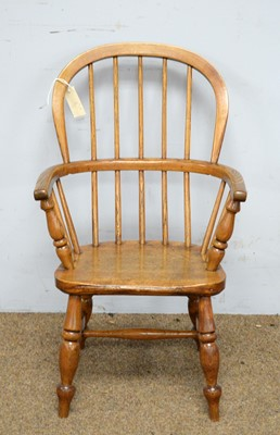 Lot 67 - 19th C child's oak Windsor armchair.