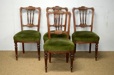 Lot 73 - Four late Victorian carved walnut dining chairs.