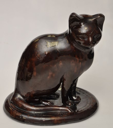 Lot 250-Canney Hill Pottery brown glaze cat of 'North...
