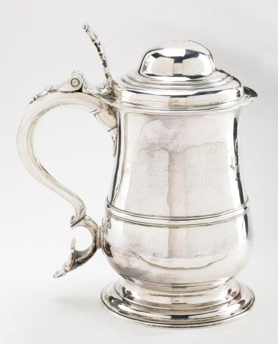 Lot 693-A George II silver lidded tankard, by John...