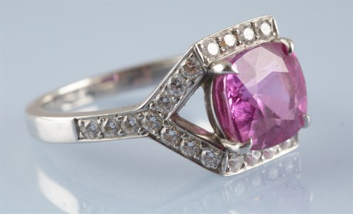Lot 878-Tiffany & Co: a pink sapphire and diamond dress...