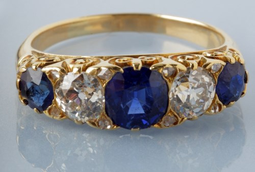 Lot 885-A sapphire and diamond ring, the central circular ...