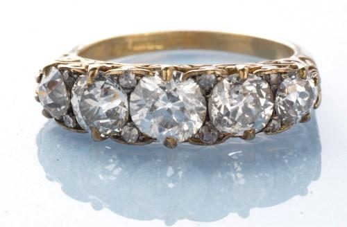 Lot 972-A five stone diamond ring, the graduated...
