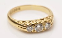 Lot 709 - A three stone diamond ring, the graduated...