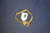 Lot 736 - A 9ct. yellow gold fancy gate link bracelet,...