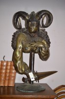 Lot 1074 - A 20th Century patinated brass figure of a...