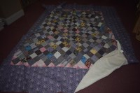 Lot 1095 - An early 20th Century patchwork Durham quilt;...