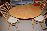 Lot 1203 - An Ercol style elm drop leaf dining table,...