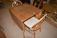 Lot 1211 - An elm Ercol drop leaf dining table, 136cms...