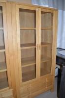 Lot 1256 - A modern oak cupboard by John Lewis, glazed...