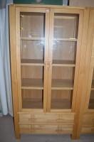 Lot 1257 - A modern oak cupboard by John Lewis, glazed...