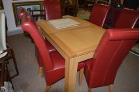 Lot 1291 - A solid oak extending dining table, one spare...
