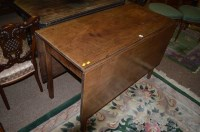 Lot 1312 - A Georgian mahogany drop leaf dining table,...
