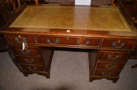 Lot 1332 - A reproduction mahogany kneehole desk with...