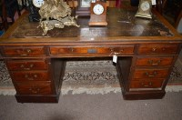 Lot 1340 - A Victorian walnut kneehole writing desk with...