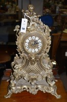 Lot 1342 - A rococo style brass mantel clock and stand,...