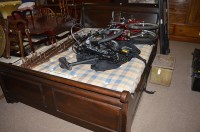 Lot 1379 - A stained oak king size sleigh bed, with...
