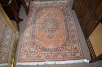 Lot 1399 - A 20th Century part silk Persian rug, pink and...