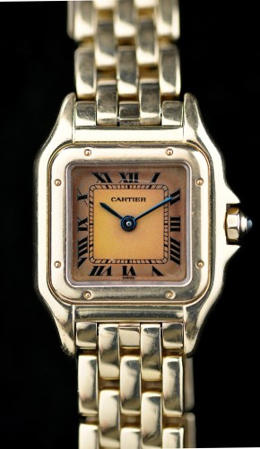 Lot 695-Cartier: an 18k gold quartz lady's Panthere...