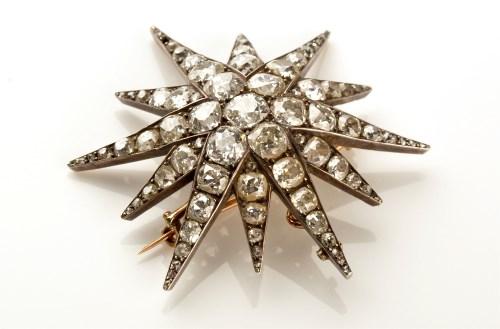 Lot 753-A Victorian diamond starburst pattern pendant,...