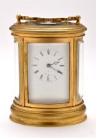 Lot 893-A French gilt brass repeating carriage clock,...