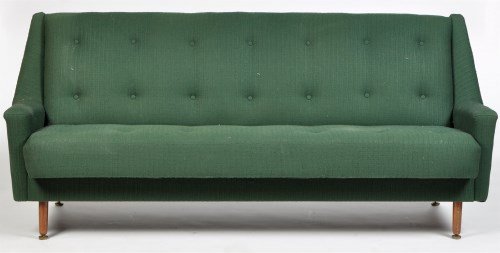 Lot 1187 - A 1960's sofa bed, upholstered in buttoned...