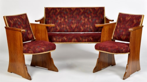 Lot 1195-An Art Deco oak three-piece suite, with padded...